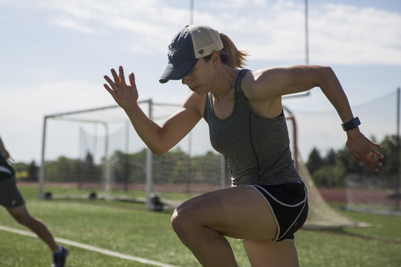 Marine Corps 1st Lt. Kerstin Caesar warms up during 2018 Department of Defense Warrior Games track practice at Cheyenne Mountain High School in Colorado Springs, Colo.