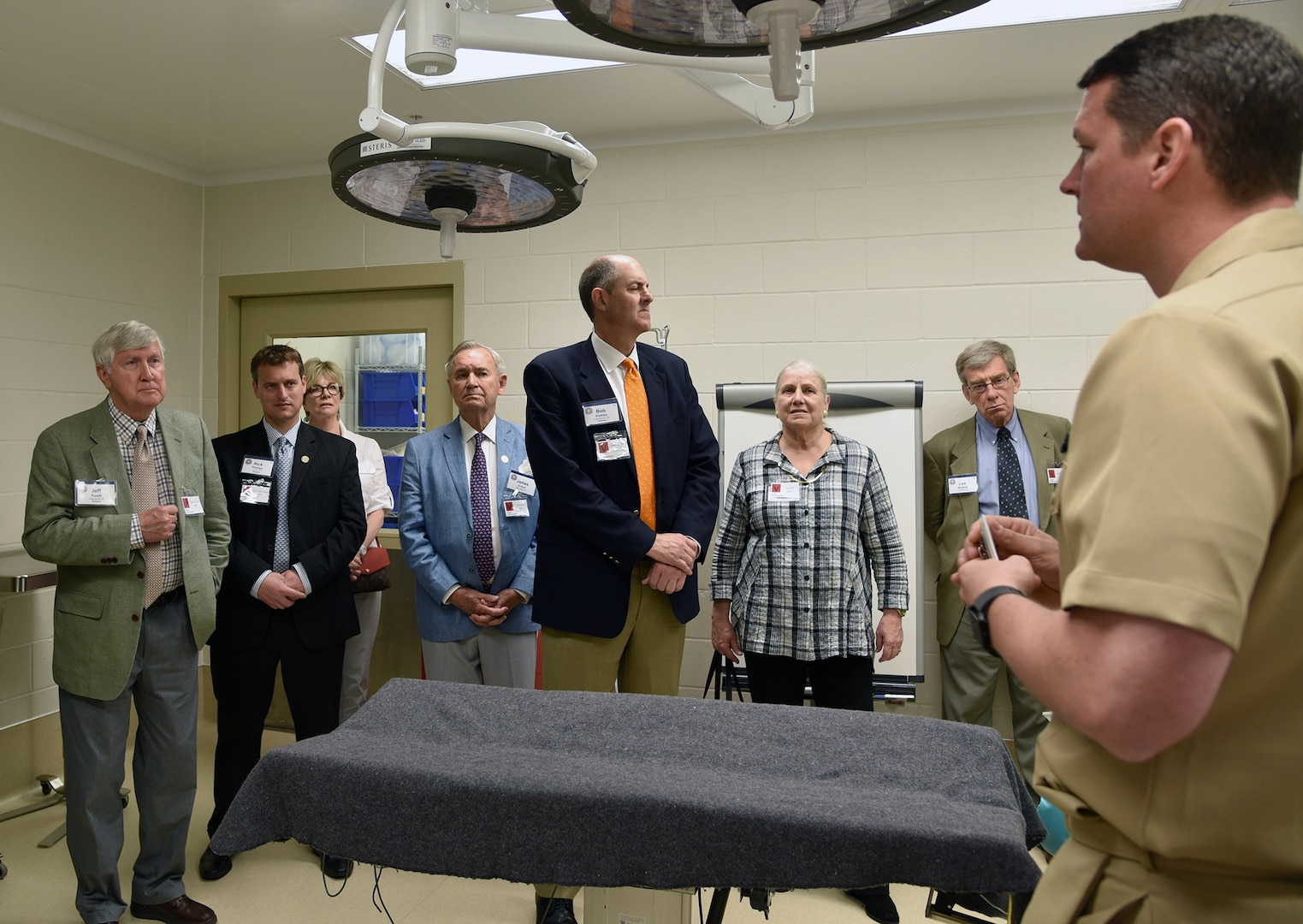Cmdr. Jacob Glaser (right), trauma surgeon and head of NAMRU-SA's Expeditionary and Trauma Medicine Department, talks to Defense Orientation Conference Association (DOCA) visitors about the most promising treatments and technologies NAMRU-SA is investigating to improve combat casualty outcomes during a tour of NAMRU-SA facilities at the Tri-Service Research Laboratory at Joint Base San Antonio-Fort Sam Houston April 27.