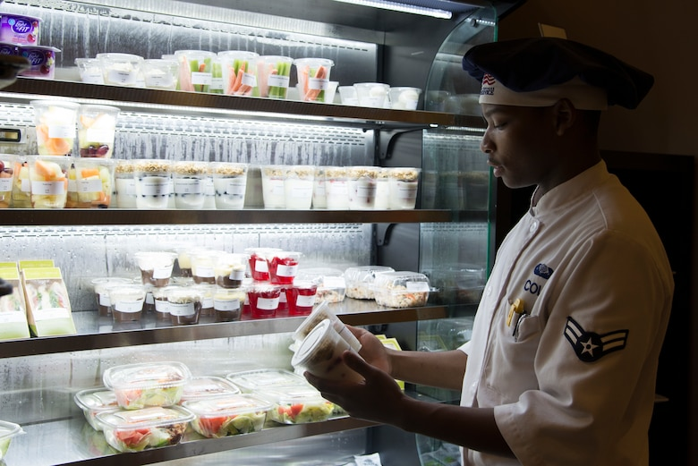 U.S. Air Force Airman 1st Class Kobe Cole, a food service journeyman assigned to the 6th Force Support Squadron, checks food labels at MacDill Air Force Base, Fla., May 30, 2018.