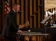 Staff Sgt. Richard Ransom, 375th Civil Engineering Squadron construction management technician, plays a drum during a Belleville Philharmonic Orchestra performance April 28, 2018, at the Saint Paul United Church of Christ in Belleville, Illinois. Ransom has been a member of the Belleville Philharmonic Orchestra for the last three years and is one of two 375th Air Mobility Wing members playing for the orchestra. (U.S. Air Force Photo by Airman 1st Class Chad Gorecki)