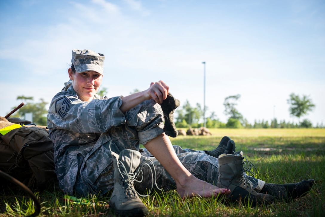 Master Sgt. Kay Williams, 919th Special Operations Security Forces Squadron, treats blisters on her feet moments after she and fellow team members completed a seven-mile ruck march May 5, 2018 near Duke Field, Fla.