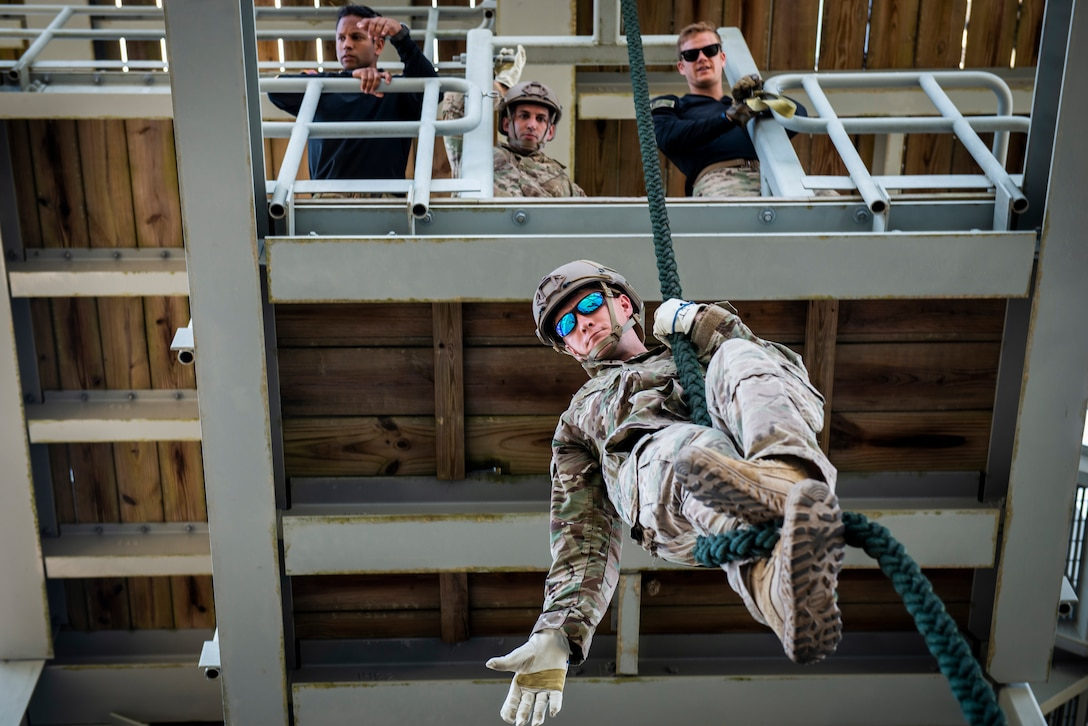 ech. Sgt. Leland Hastings, 919th Special Operations Security Forces Squadron, demonstrates fast rope braking procedures as he lowers himself from a tower May 5, 2018 on Eglin Air Force Base, Fla.