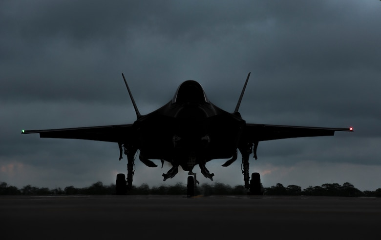 An F-35A Lightning II awaits permission to taxi May 30, 2018, at Eglin Air Force Base, Fla. The 33 FW conducted F-35A night flying operations May 29-31, 2018, satisfying a training requirement for student pilots who will routinely fly day and night operations upon entering the combat Air Force. During this iteration of the pilot training syllabus, the night flying portion was stretched later into evening hours than in the past, allowing for more qualifications to be checked off across fewer days. (U.S. Air Force photo by Airman 1st Class Emily Smallwood)