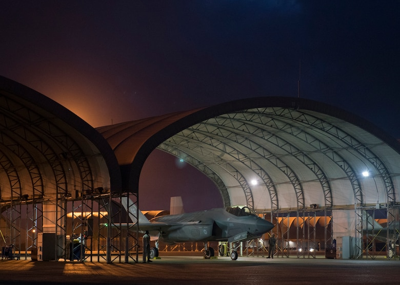 An F-35A Lightning II assigned to the 33rd Fighter Wing awaits permission to taxi May 30, 2018, at Eglin Air Force Base, Fla. The 33 FW conducted F-35A night flying operations May 29-31, 2018, satisfying a training requirement for student pilots who will routinely fly day and night operations upon entering the combat Air Force. During this iteration of the pilot training syllabus, the night flying portion was stretched later into evening hours than in the past, allowing for more qualifications to be checked off across fewer days. (U.S. Air Force photo by Staff Sgt. Peter Thompson)