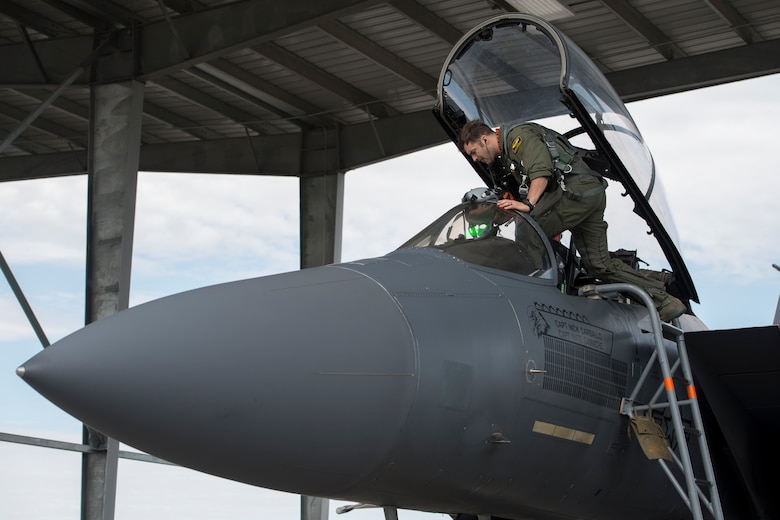Capt. Nick Carballo, 391st Fighter Squadron pilot, enters an F-15E Strike Eagle during an exercise, May 23, 2018 at Mountain home Air Force Base, Idaho. Gunfighter Flag 18-2 encompassed both the Belgian Air Component and Idaho Civil Air Patrol. (U.S. Air Force photo by Airman 1st Class JaNae Capuno)