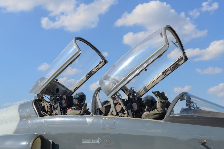 Second Lieutenant Colin Asbury, 47th Flying Training Wing pilot graduate, signals to pull chocks before one of his final training flights at Laughlin Air Force Base, Texas, May 15, 2018. After 52 weeks of Specialized Undergraduate Pilot Training, Asbury moves on to fly his aircraft of choice the F-15E Strike Eagle. The wings Asbury received upon graduation first entered service in 1941, and makes him the third carrier of this particular pair. (U.S. Air Force photo by Senior Airman Benjamin N. Valmoja)
