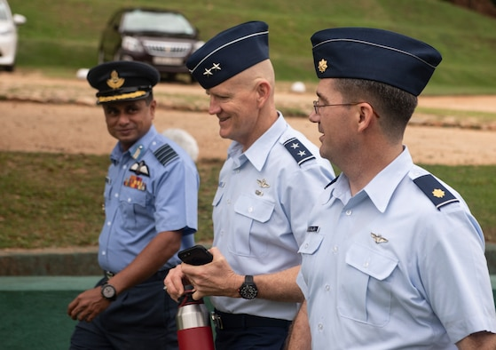 U.S. Air Force Maj. Jeffery Dallas, 5th Air Force foreign affairs officer, right, talks with Maj. Gen. James O. Eifert, Air National Guard assistant to the commander of Pacific Air Forces, and Sri Lanka Air Force Group Capt. Deshapriya Silva, Junior Command and Staff College (JCSC) commanding officer, mid-May, 2018, at the JCSC, Sri Lanka.