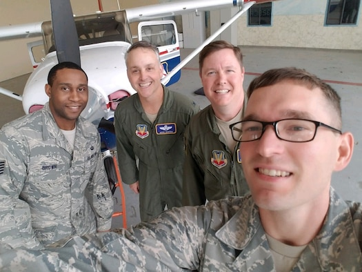 Tech. Sgt. Ben Brown (far left), and Staff Sgt. Aaron Pearson (far right), both subject matter experts from the Business and Enterprise Systems Directorate, receive servers from Tyndall Air Force Base, that were delivered by members of the Civil Air Patrol (courtesy photo).