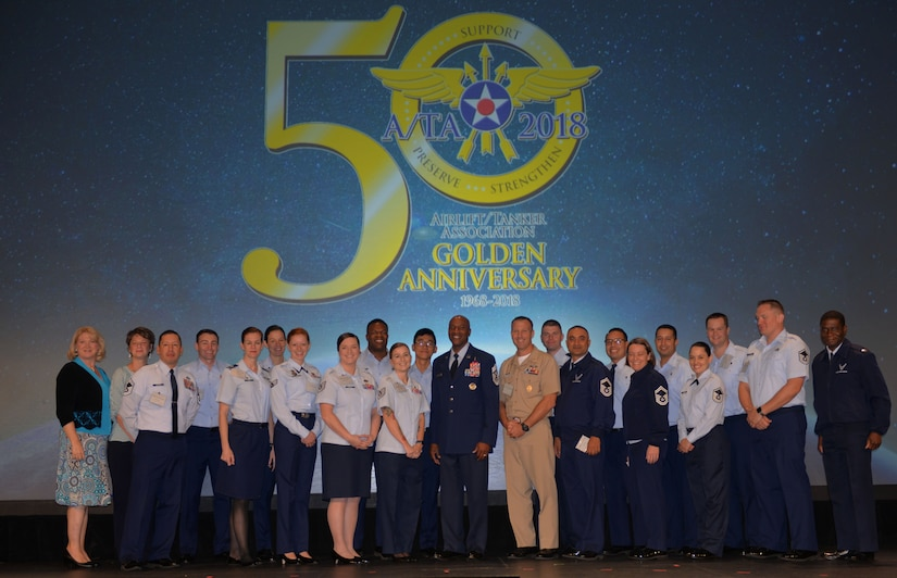 Members of Joint Base Charleston pose for a picture with Chief Master Sgt. Kaleth Wright, Chief Master Sgt. of the Air Force, at the 2018 Airlift/Tanker Association and AMC Symposium held at the Gaylord Texan Resort in Grapevine, Texas Oct. 25-28, 2018. The symposium offered JB Charleston Airmen and commanders an opportunity to interact with top military leaders and ask questions about the future of the Air Force.