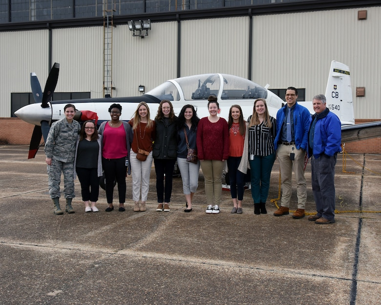 Mississippi State University veterinary students stand in front of a T-6 Texan II Oct. 23, 2018, on the flight line at Columbus Air Force Base, Mississippi. The students gained an opportunity to visit the 14th Security Forces Squadron Military Working Dog Kennel and static displays of aircraft. (U.S. Air Force photo by Sharon Ybarra)