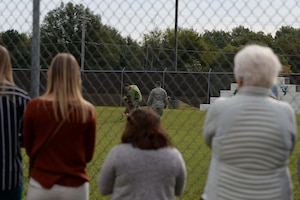Mississippi State University veterinary students watch as Airman 1st Class Ryan Younger, 14th Security Forces Squadron installation entry controller, gets bit by military working dog Dito as Senior Airman Marini, 14th SFS MWD handler, gives orders Oct. 23, 2018, at the MWD kennel on Columbus Air Force Base, Mississippi. Members of the 14th SFS MWD Kennel showcased real world scenarios in a training environment to give a better understanding of the lifestyle of an MWD. (U.S. Air Force photo by Airman Hannah Bean)
