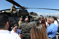 National Defense College students talk about helicopter capabilities with subject matter experts during a visit to Soto Cano Air Base, Honduras, Oct. 25, 2018.
