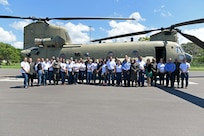 National Defense College students stand for a photo after their aircraft tours at Soto Cano Air Base (SCAB), Honduras, Oct. 25, 2018.