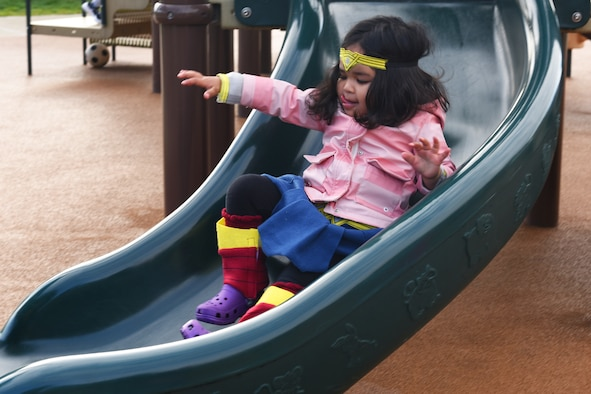 A child of two active duty Airmen slides down a slide at the Child Development Center-East at Royal Air Force Lakenheath, England, Oct. 31, 2018. RAF Lakenheath has expanded its child care services off-base to help Liberty Airmen and their families receive child care without delay. (U.S. Air Force photo/Airman 1st Class Christopher S. Sparks)