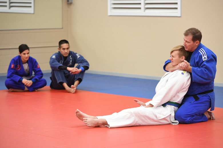 Hill Judo coach Don Chesmer demonstrates a choking technique with Zac Phipps, one of his long-time students, during a free interactive training session at Hess Fitness Center on World Judo Day Oct. 30. (U.S. Air Force photo by Cynthia Griggs)