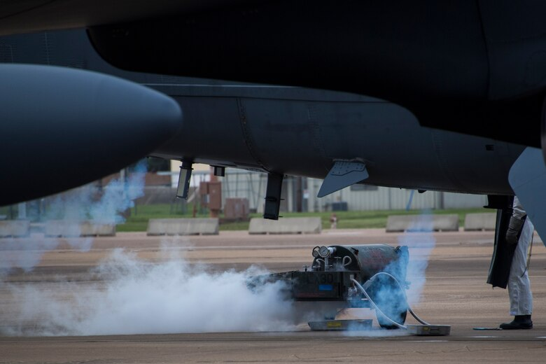 Liquid nitrogen creates a cloud as an Airman prepares to maintain oxygen bottles aboard a B-52 Stratofortress at Barksdale Air Force Base, Louisiana, Oct. 10, 2018.  Although routine maintenance, the bottles are a critical piece of equipment aboard the jet, as it can reach altitudes of up to 50,000 feet. (U.S. Air Force photo by Master Sgt. Ted Daigle)
