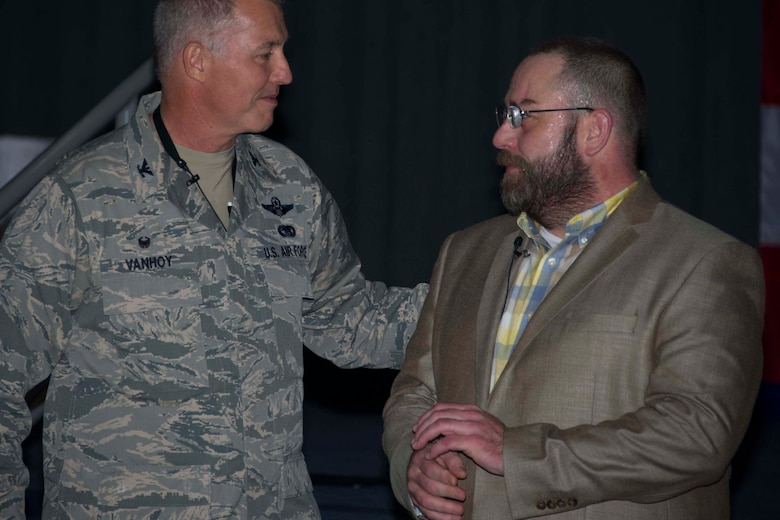 U.S. Air Force Col. Robert VanHoy, 307th Bomb Wing Commander, thanks Tom Knudsen during a Wingman Day presentation at Barksdale Air Force Base, Louisiana, Oct. 14, 2018.   Knudsen, an Air Force veteran, gave his testimony on resilience to the Citizen Reserve Airmen in attendance.  He was wounded multiple times during a tour overseas and overcame many obstacles on his road to recovery. (U.S. Air Force photo by A1C Maxwell Daigle)