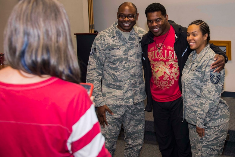 Former Heisman Trophy winner and NFL running back, Herschel Walker, poses with Airmen during a visit to Barksdale Air Force Base, Louisiana, Oct. 15, 2018.  He came to the 307th Bomb Wing headquarters building to discuss resiliency and how he coped with his own battles with dissociative identity disorder.  He also took time to answer questions about his career and sign memorabilia. (U.S. Air Force photo by Master Sgt. Ted Daigle)