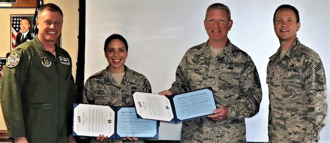 Col. Allen Duckworth, commander of the 340th Flying Training Group, JBSA-Randolph, Texas, poses with new SNCO inductees, Master Sgt. Angelina Manby, Senior Master Sgt. Craig Pfister and 340th FTG group superintendent, Chief Master Sgt. Scott A. Goetze following ceremonies here Nov. 1. (U.S. Air Force photo by Janis El Shabazz)