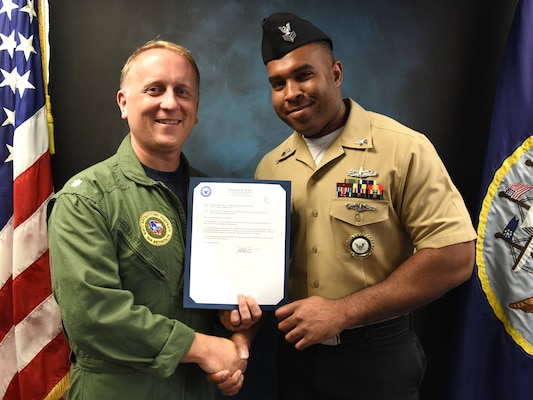 Vincent Barnes (right), assigned to Navy Recruiting Station New Braunfels, was meritoriously advanced to the rank of petty officer first class during a promotion ceremony held at Navy Recruiting District San Antonio Headquarters by Cmdr. Jeffrey Reynolds.