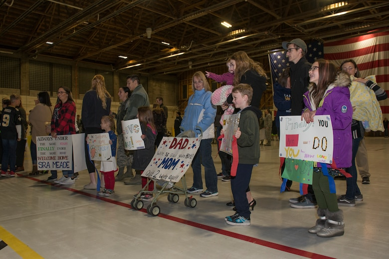 Familiy memebers await the return of the 726th Air Control Squadron Airman, Moumtain Home Air Force Base, October 27, 2018. The Airmen of the 726th ACS Airmen returned home from a six-month deployment. (U.S. Air Force photo by Senior Airman Tyrell Hall)