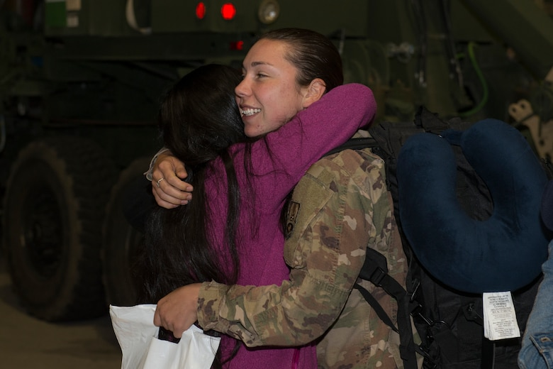 An Airman from the 726th Air Control Squadron returns from deployment and embraces her friend, October 27, 2018, at Mountain Home Air Force Base, Idaho. Over 100 Airmen from the 726th ACS deployed with mission of supporting communication between air craft and ground units. (U.S. Air Force photo by Senior Airman Tyrell Hall)
