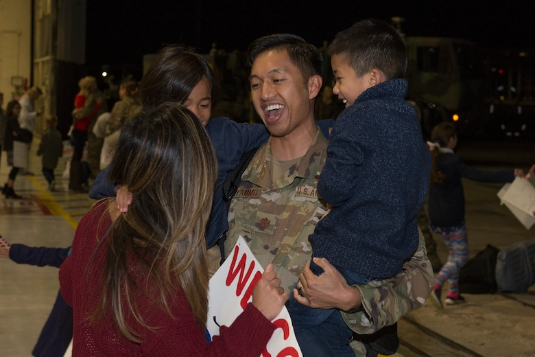 An Airman from the 726th Air Control Squadron returns from deployment and is greeted by his family, October 27, 2018, at Mountain Home Air Force Base, Idaho. 120 Airmen from the 726th ACS deployed with mission of supporting communication between air craft and ground units. (U.S. Air Force photo by Senior Airman Tyrell Hall)