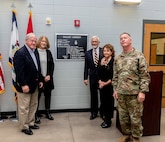 Maj. Gen. James Hoyer, Adjutant General of the West Virginia National Guard unveils a plaque for brothers Phillip and Claude Gaujot and their wives honoring their great uncles Antoine and Julien Gaujot, Nov. 1, 2018, at the Logan/Mingo Readiness Center in Omar, West Virginia. The West Virginia National Guard armory was dedicated in honor of the brothers , both Congressional Medal of Honor recipients and former Soldiers who served in the late 1800's and early 1900's. (West Virginia National Guard photo by Bo Wriston)