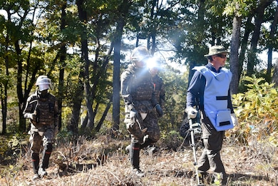 Tom Meeks (far right), a United States  Army Corps of Engineers, Engineering and Support Center quality control representative, surveys an area near the South Korea Demilitarized Zone along with Republic of Korea Army engineer soldiers during a mine clearing mission, Oct. 19.
