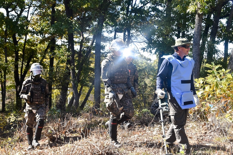 Tom Meeks (far right), a United States  Army Corps of Engineers, Engineering and Support Center quality control representative, surveys an area near the South Korea Demilitarized Zone along with Republic of Korea