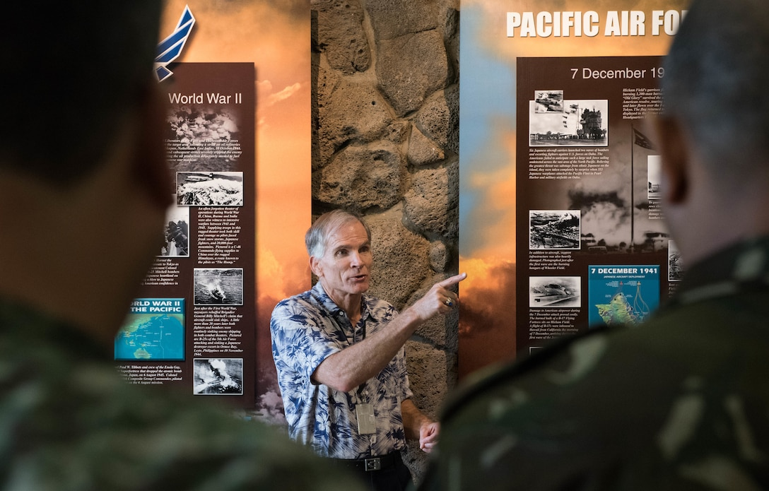 Charles Nicholls, Pacific Air Forces (PACAF) historian, gives an account of the Pearl Harbor attack for a group of more than 30 foreign attachés during a tour to Headquarters PACAF, Joint Base Pearl Harbor-Hickam, Hawaii, Oct. 23, 2018.