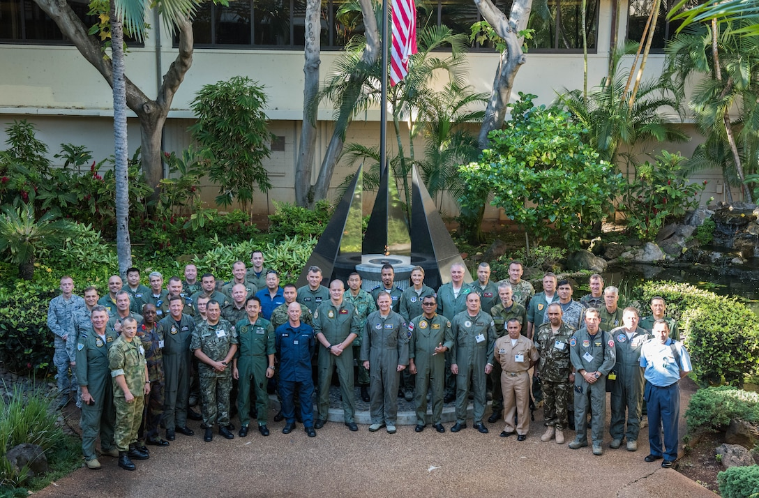 Maj. Gen. Russ Mack, Pacific Air Forces (PACAF) deputy commander, takes a photo with foreign attachés during a tour of Headquarters PACAF, Joint Base Pearl Harbor-Hickam, Hawaii, October 23, 2018.