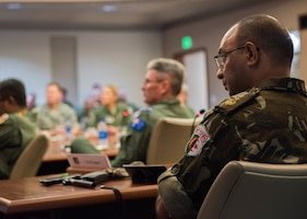 Algerian air force Col. Hadj Neggaz listens to a briefing in the Kenney Conference Room at Headquarters Pacific Air Forces (PACAF) during a foreign attaché tour of Joint Base Pearl Harbor-Hickam, Hawaii, Oct. 23, 2018.