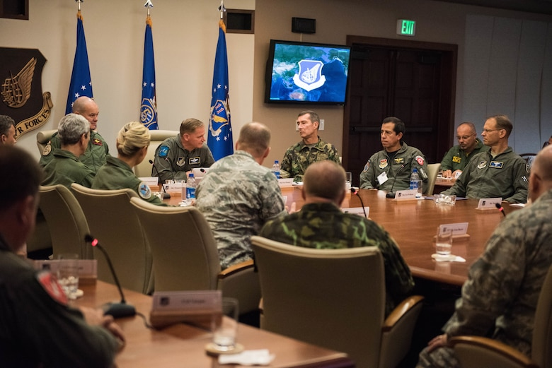 Maj. Gen. Russell L. Mack, Pacific Air Forces (PACAF) deputy commander, talks to foreign attachés during their visit to Headquarters PACAF at Joint Base Pearl Harbor-Hickam, Hawaii, Oct. 23, 2018.