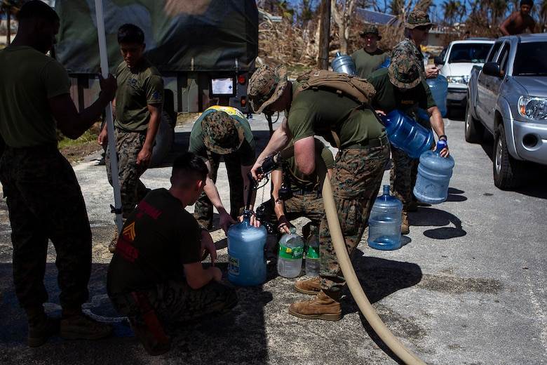 Marines with the 31st Marine Expeditionary Unit and Combat Logistics Battalion 31 pump purified water for citizens of Tinian, Commonwealth of the Northern Mariana Islands, Oct. 31, 2018. Marines with the 31st MEU and CLB-31 arrived on Tinian Oct. 29-30 in the wake of Super Typhoon Yutu as part of the U.S. Defense Support of Civil Authorities here. The Marines can purify more than 20-thousand gallons of sea water each day to meet the urgent needs of the people of Tinian. The Marines arrived at the request of CNMI officials and the U.S. Federal Emergency Management Agency to assist relief efforts in the wake of Yutu, the largest typhoon to ever hit a U.S. territory. The 31st MEU, the Marine Corps' only continuously forward-deployed MEU, provides a flexible force ready to perform a wide-range of military operations across the Indo-Pacific region. (U.S. Marine Corps photo by Gunnery Sgt. T. T. Parish/Released)
