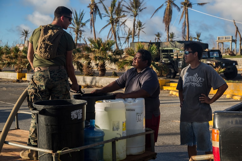 Lance Cpl. Eric Russell, a basic water support technician with Combat Logistics Battalion 31, pumps purified water for citizens of Tinian, Commonwealth of the Northern Mariana Islands, Oct. 31, 2018. Russell, a native of Muskegon, Michigan, graduated from Oakridge High School in June 2017 before enlisting in November the same year. Marines with the 31st Marine Expeditionary Unit and CLB-31 arrived on Tinian Oct. 29-30 in the wake of Super Typhoon Yutu as part of the U.S. Defense Support of Civil Authorities here. The Marines arrived at the request of CNMI officials and the U.S. Federal Emergency Management Agency to assist relief efforts in the wake of Yutu, the largest typhoon to ever hit a U.S. territory. The 31st MEU, the Marine Corps' only continuously forward-deployed MEU, provides a flexible force ready to perform a wide-range of military operations across the Indo-Pacific region. (U.S. Marine Corps photo by Lance Cpl. Hannah Hall/Released)