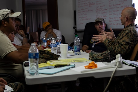 "Col. Robert ""Bams"" Brodie, commander of the 31st Marine Expeditionary Unit, speaks with local elected officials of Tinian, Commonwealth of the Northern Mariana Islands, after arriving to support relief efforts here in the wake of Super Typhoon Yutu, Oct. 29, 2018. Marines with the 31st MEU and Combat Logistics Battalion 31 arrived on Tinian in the wake of Super Typhoon Yutu as part of the U.S. Defense Support of Civil Authorities here. The Marines arrived at the request of CNMI officials and the U.S. Federal Emergency Management Agency to assist relief efforts in the wake of Yutu, the largest typhoon to ever hit a U.S. territory. The 31st MEU, the Marine Corps' only continuously forward-deployed MEU, provides a flexible force ready to perform a wide-range of military operations across the Indo-Pacific region. (U.S. Marine Corps photo by Gunnery Sgt. T. T. Parish/Released)"