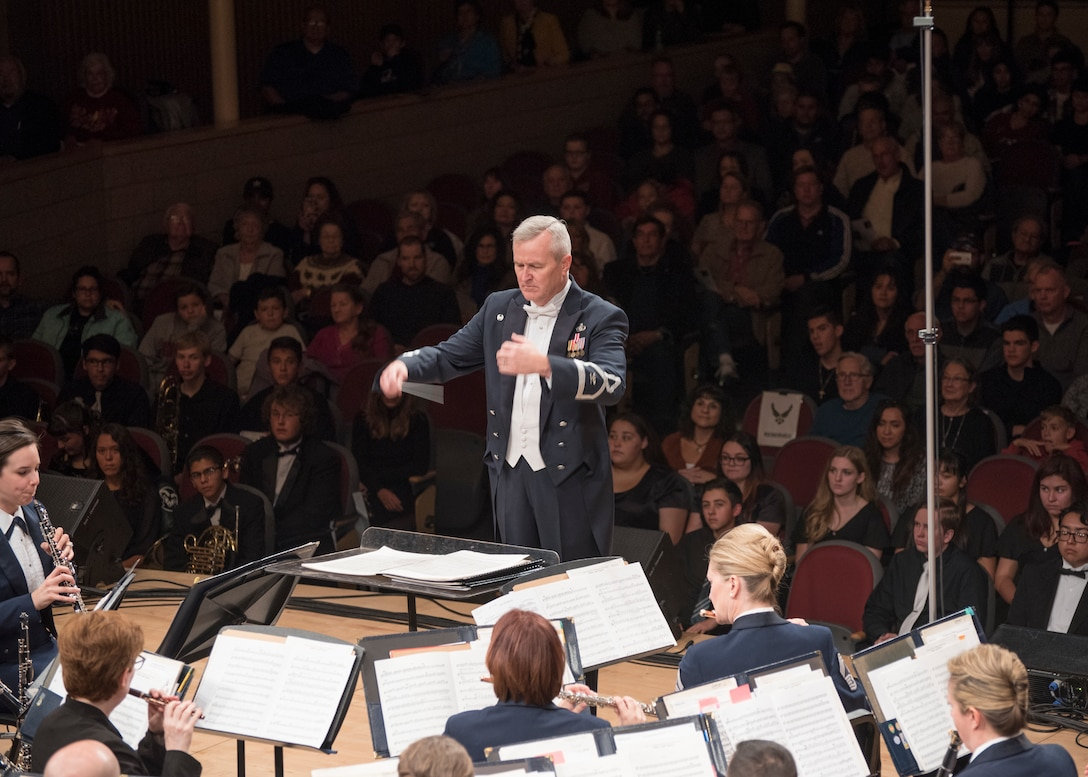 Col. Larry H. Lang, U.S. Air Force Band commander and conductor, leads the band during a performance at the V. Sue Cleveland High Concert Hall in Rio Rancho, N.M., Oct. 17, 2018. On Lang's final trip before retirement, the band toured 12 locations in New Mexico and Texas, including Lang's hometown of El Paso, Texas. (U.S. Air Force photo by Senior Airman Abby L. Richardson)