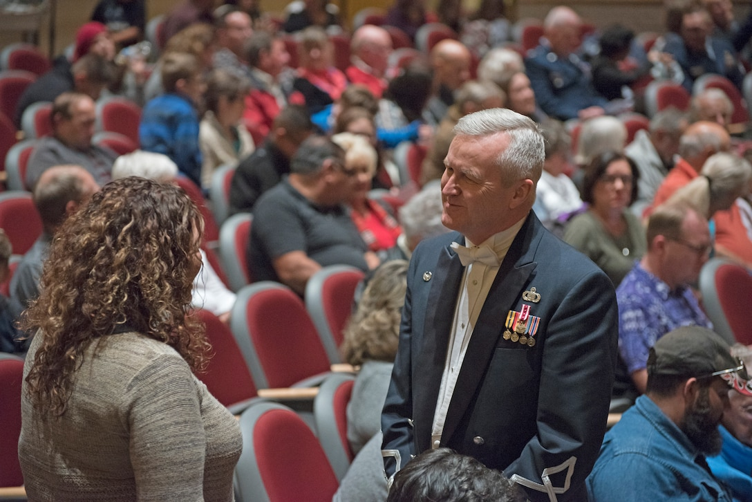 Col. Larry H. Lang, U.S. Air Force Band commander and conductor, speaks with an audience member before the band's concert at the V. Sue Cleveland High Concert Hall in Rio Rancho, N.M., Oct. 17, 2018. For the last tour of Lang's career, he led the band through 12 concerts at locations across New Mexico and Texas. (U.S. Air Force photo by Senior Airman Abby L. Richardson)
