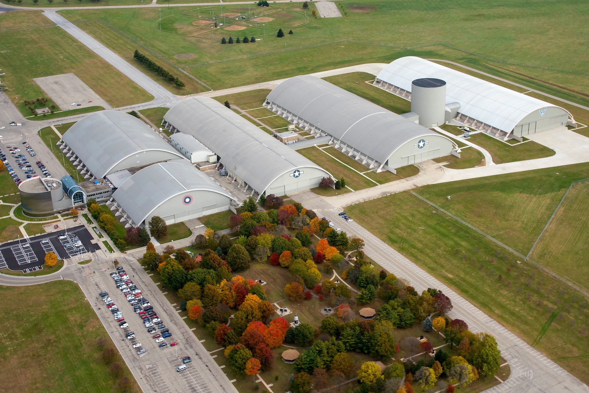 DAYTON, Ohio (10/2018) -- Aerial view of the National Museum of the U.S. Air Force. The museum collects, researches, conserves, interprets and presents the Air Force's history, heritage and traditions, as well as today's mission to fly, fight and win...in Air, Space and Cyberspace to a global audience through engaging exhibits, educational outreach, special programs, and the stewardship of the national historic collection. (U.S. Air Force photo by Ken LaRock, pilot Matt Kiefer)