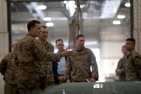 Airmen from the 455th Expeditionary Logistics Readiness Squadron give Lt. Gen. Joseph Guastella, commander of U.S. Air Forces Central Command, a tour of their facilities at Bagram Airfield, Afghanistan, Oct. 29, 2018.