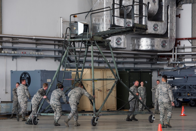 Members of the 721st Aircraft Maintenance Squadron push a B-2 maintenance platform and work access stand as part of the maintenance relay during a 721st Air Mobility Operations Group safety down day on Ramstein Air Base, Germany, Oct. 19, 2018. In addition to the relay, physical fitness, resilience and other wingman concepts were all included in the safety down day. (U.S. Air Force photo by Senior Airman Devin M. Rumbaugh)