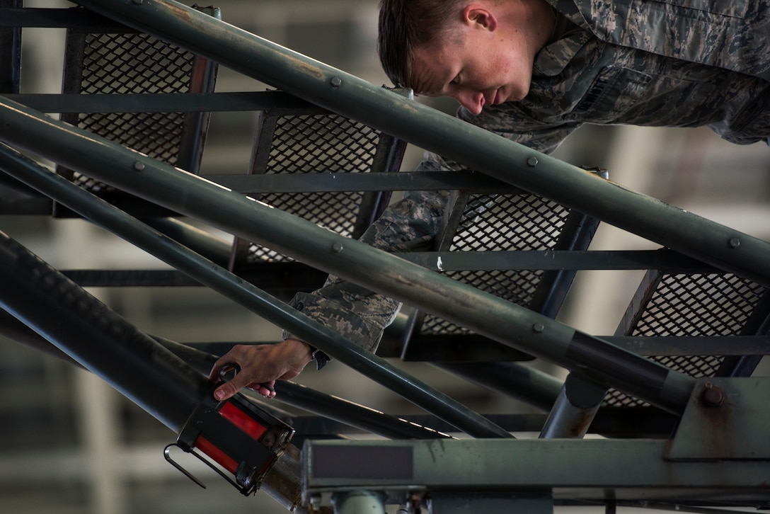 A U.S. Air Force 721st Air Mobility Operations Group airman engages the locking ram on a B-2 maintenance platform and work access stand as part of the maintenance relay during the 721st AMOG safety down day on Ramstein Air Base, Germany, Oct. 19, 2018. In addition to the relay, physical fitness, resilience and other wingman concepts were all included in the safety down day. (U.S. Air Force photo by Senior Airman Devin M. Rumbaugh)