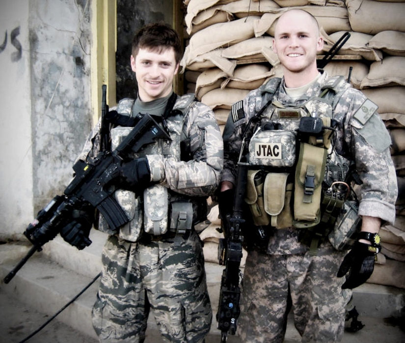 Senior Airmen Mike Malarsie and Bradley Smith pose for a photo during their Afghanistan deployment. An improvised explosive device attack mortally wounded Airman Smith and injured Airman Malarsie Jan. 3, in Afghanistan.