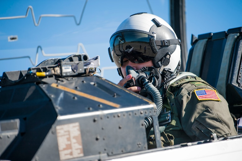U.S. Navy Ensign Quinn Nystrom, a student naval flight officer assigned to Training Squadron 86 (VT-86) from Naval Air Station Pensacola, Fla., checks his communication system before a training flight at MacDill Air Force Base, Fla., Oct. 31, 2018.