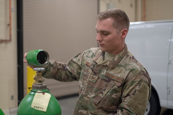 Staff Sgt. James Mizell, 931st Maintenance Squadron Electrical and Environmental journeyman, places a cap on a gaseous oxygen tank Oct. 14, 2018, McConnell Air Force Base, Kan.
