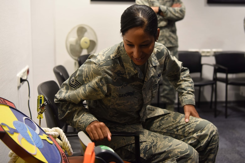 Tech Sgt. Olivia Sandrini, 721st Aircraft Maintenance Squadron, command support staff and programs section chief, receives a call from Gen. Stephen W. Wilson, Vice Chief of Staff of the Air Force, on Ramstein Air Base, Germany, Nov. 1, 2018. Sandrini was selected to attend officer's training school via the Senior Leader Enlisted Commission Program.