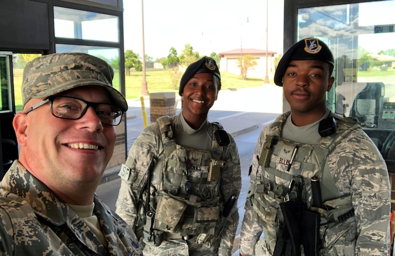 Master Sgt. Christopher Evans, 22nd Air Refueling Wing career assistance advisor, visits with members of the 22nd Security Forces Squadron at McConnell Air Force Base, Kansas. CAAs assist commanders and supervisors in career planning, progression and provide interpretations of applicable policies and programs. (Courtesy photo)