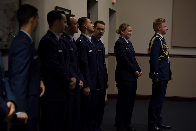 Specialized Undergraduate Pilot Training Class 19-01 students prepare for their graduation, Oct. 26, 2018, on Columbus Air Force Base, Mississippi. Student pilots must complete roughly a year of training before earning their silver wings and the title of U.S. Air Force pilot. (U.S. Air Force photo by Airman 1st Class Keith Holcomb)