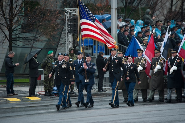 Soldiers and Airmen of the Nebraska and Texas National Guard carry the United States flag while representing the United States during the Czech Republic Military Parade, Oct. 28, 2018, in Prague, Czech Republic. The parade was part of a weekend celebration marking the 100th anniversary of the establishment of Czechoslovakia in 1918. Representing the United States during the parade were: Tech. Sgt. Darren Davlin (Nebraska), Senior Airman Avery Prai (Nebraska), Pfc. Alexa Nelson (Nebraska), Sgt. 1st Class Robb Miller (Texas), Staff Sgt. Eric Halliburton (Texas), and Sgt. Adrian Tejerina (Texas).